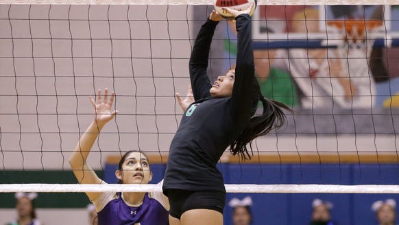 Montwood setter Cassidy Sanchez jump sets while covered