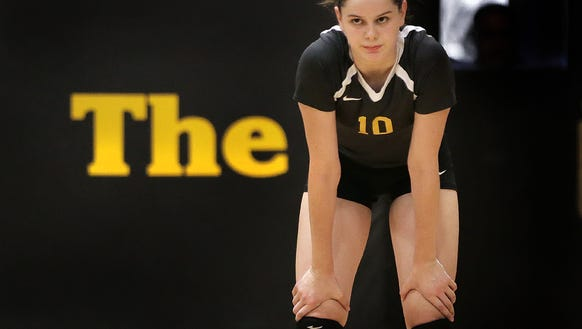 The Caitlan Buettner awaits serve from a Loretto player