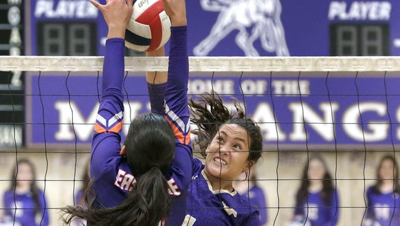 Meghan Cereceres of Burges hits into an Eastlake blocker