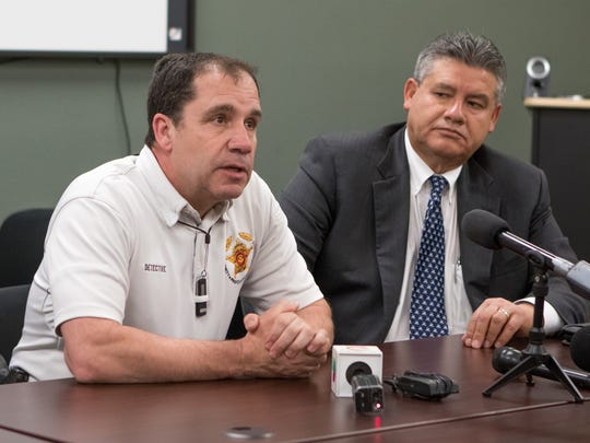 Ken Roberts, president of the Doña Ana County Sheriff's Deputies Association speaks to the media at a news conference in April inside DASO headquarters. Roberts and Sheriff Enrique Vigil, right, discredited a commissioned study showing the department is adequately staffed.