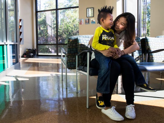 Andrew Tran, 5, laughs with his mom Silone Tran, 30, before his dentist appointment at the NCEF Pediatric Dental Center on the campus of Florida SouthWestern on Monday, May 15, 2017.