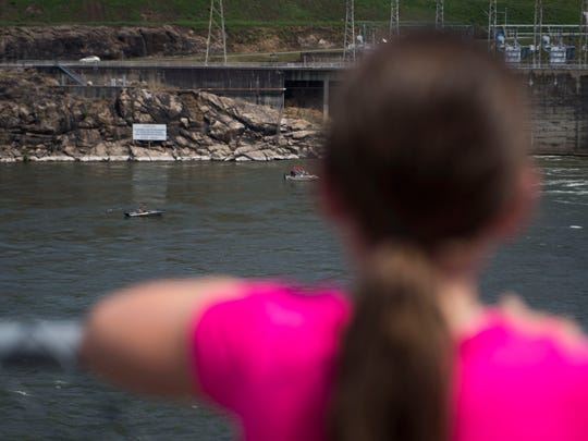Lorna Bandy, 8, of Lenoir City, looks at boats on the river during a tour of the Fort Loudoun Lock on the Tennessee River, given by The U.S. Army Corps of Engineers Nashville District and Tennessee Valley Authority in Lenoir City, Saturday, June 9, 2018.