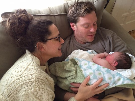Sarah and Brian Bonovich admire their new daughter