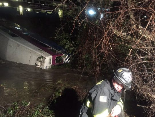 Rescue operations underway at the site of a train derailment