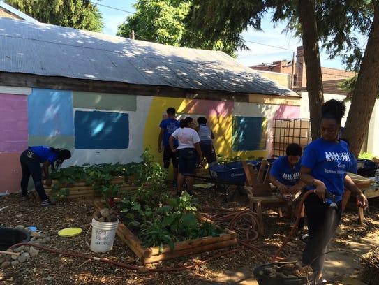 Volunteers from Crispus Attucks work to build a community