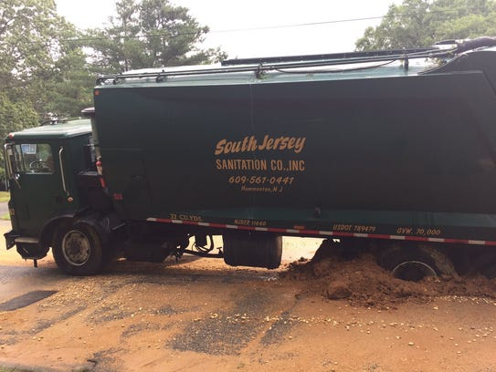 A South Jersey Sanitation Co. truck struck in a trench