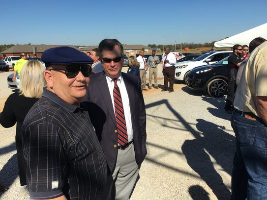 Bill Powers, right, of Wyatt-Johnson visits with Ronald