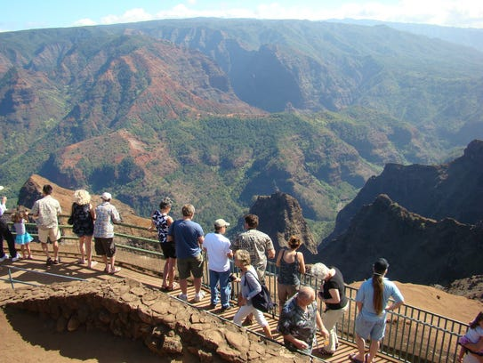 This Jan. 5, 2012 photo shows tourists lining up to