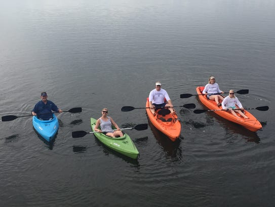 Jennifer Trefelner (in the green kayak) and her family