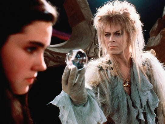 Goblin king David Bowie tempts teenager Jennifer Connelly,