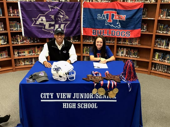 City View's Danny Ho (left) and Kayla Wampler signed