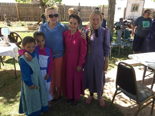 Hildale resident Christine Marie Katas poses with children