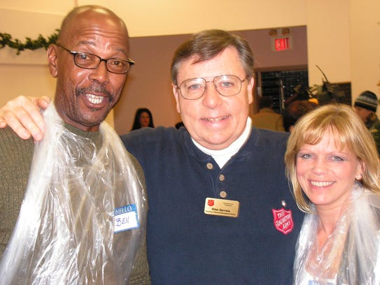 Mike Servais with two Salvation Army volunteers at