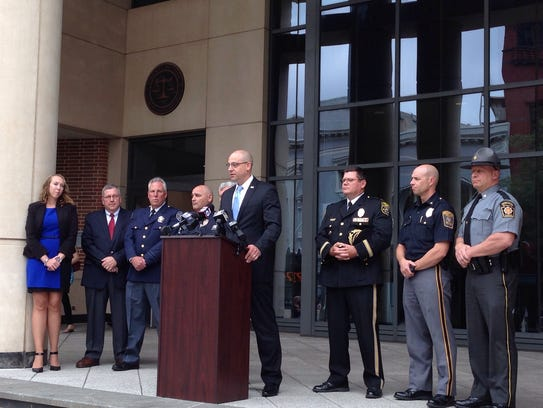 Chief deputy prosecutor Dave Sunday (at podium) announces