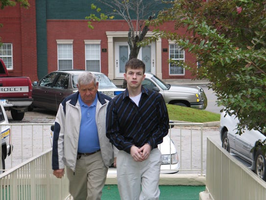 In this Oct. 20, 2006 photo, Evan Miller, right, is