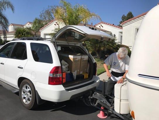 Oxnard resident John Mason hooks up his travel trailer