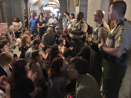 Protesters block the door to Gov. Bill Haslam's office