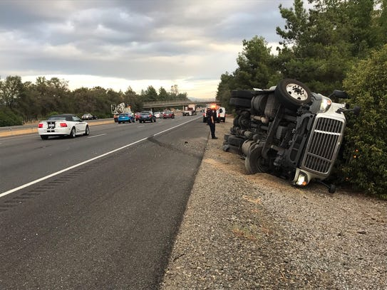 A big rig truck overturned on Interstate 5 near the