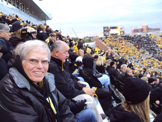 Bob Morrow in a familiar spot, Row 68 of Kinnick Stadium.