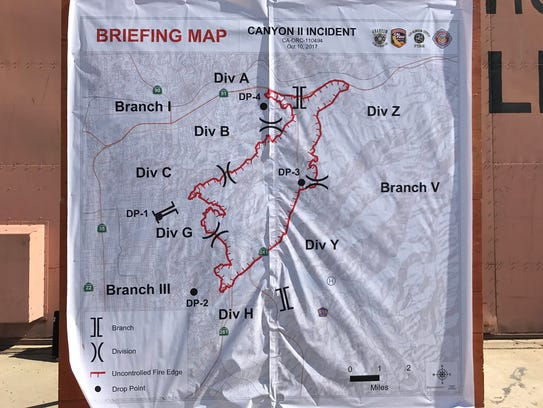 Firefighters displayed a map of Canyon Fire 2 in Orange