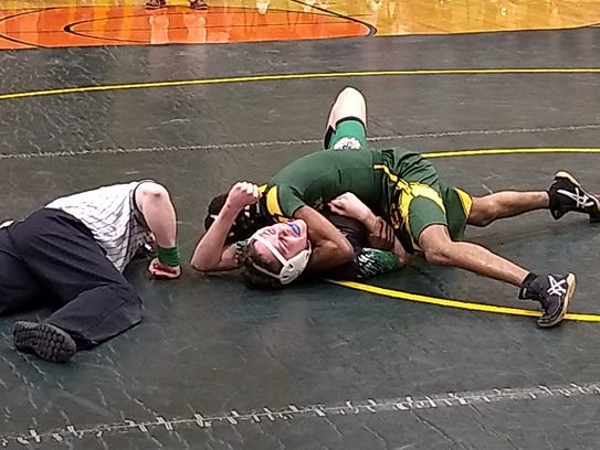 Logan Trader wrestles in the 106 class for the Mardela