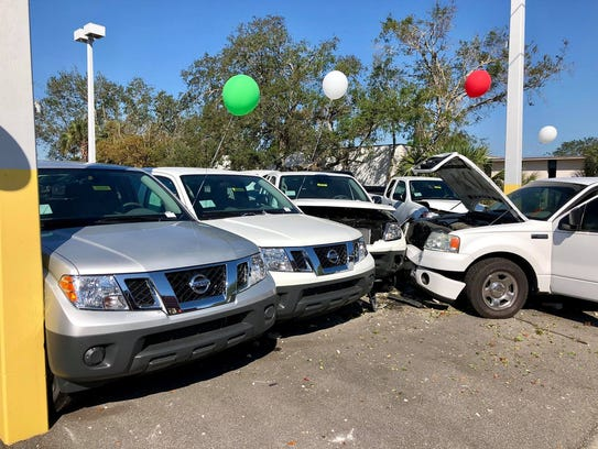 No injuries were reported in a crash at a car dealership