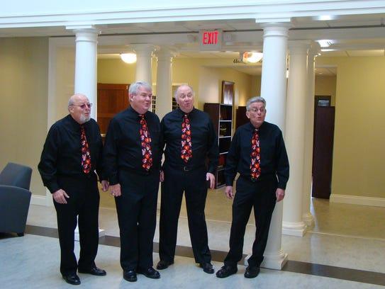 Ron Pierson, left to right, Jack Ostmark, Bud Fair