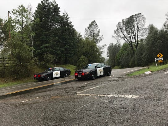California Highway Patrol cars block off Placer Road