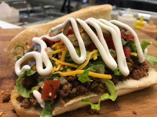Taco sub sandwich at Monster Subs on Peters Road is made with taco meat, lettuce, cheddar cheese, sour cream, homemade pico de gallo and jalapeños.