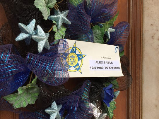 A wreath hangs at York City Police headquarters in