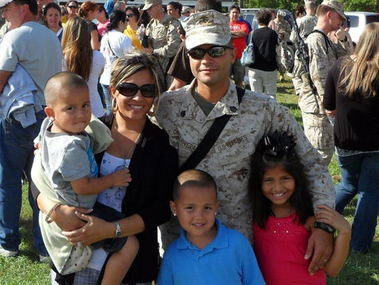 Staff Sgt. Javier Ortiz-Rivera with his wife Veronica,