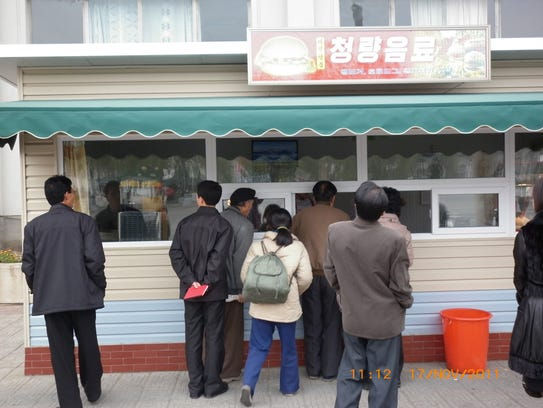 Customers line up at a takeout location of Samtaesong,