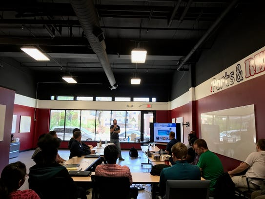 Ryan Weber talks to students at Great North Labs, a