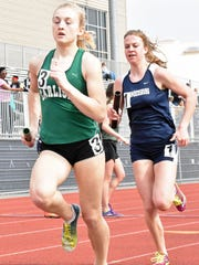Chambersburg's Abby Yourkavitch chases down Carlisle's Meg Lebo during the 4x800 at the 12th annual Tim Cook Invitational at Chambersrburg on Saturday, March 25, 2017.