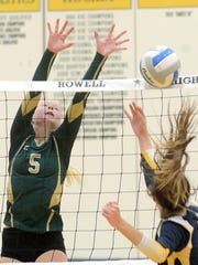 Howell's Justina Frantti blocks a South Lyon shot in
