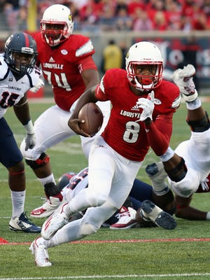 Louisville's Lamar Jackson rushes for his 2nd TD of the game against Samford.