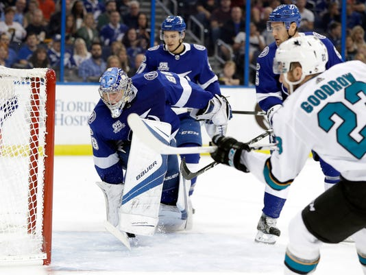 Tampa Bay Lightning goalie Andrei Vasilevskiy (88) cannot make the save on a goal by San Jose Sharks right wing Barclay Goodrow (23) during the first period of an NHL hockey game Saturday, Dec. 2, 2017, in Tampa, Fla. (AP Photo/Chris O'Meara)