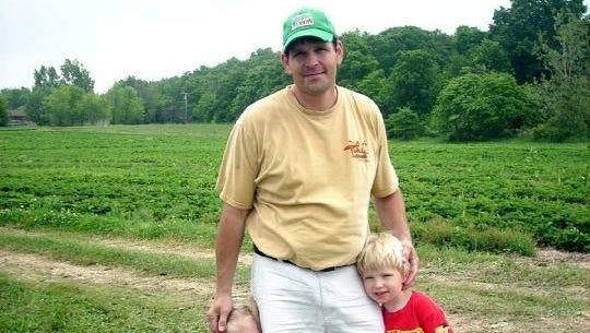 Derek Flemming with his children.