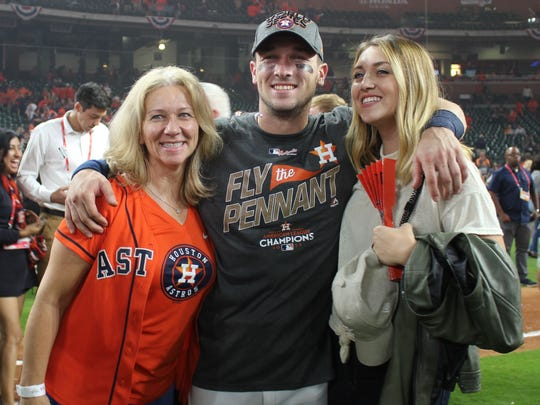 Houston Astros third baseman Alex Bregman celebrates a berth in the World Series with his mother, Jackie (left), and sister, Jessica.