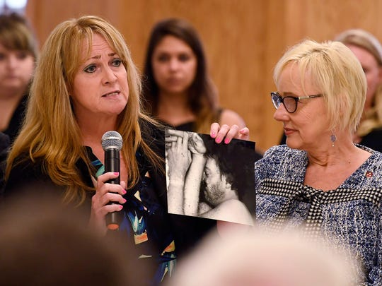 Anna Whaley holds a photo of victim Johnny Allen Wednesday, May 23, 2018, during the clemency hearing for Cyntoia Brown at Tennessee Prison for Women in Nashville, Tenn. Brown is the Nashville woman sentenced to life in prison at age 16 for the murder. It is her first bid for freedom before a parole board since the 2004 crime.
