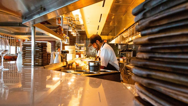 Employees work in the kitchen at 1000 North in Jupiter, the restaurant and private club co-owned by Michael Jordan, Ernie Els and others.