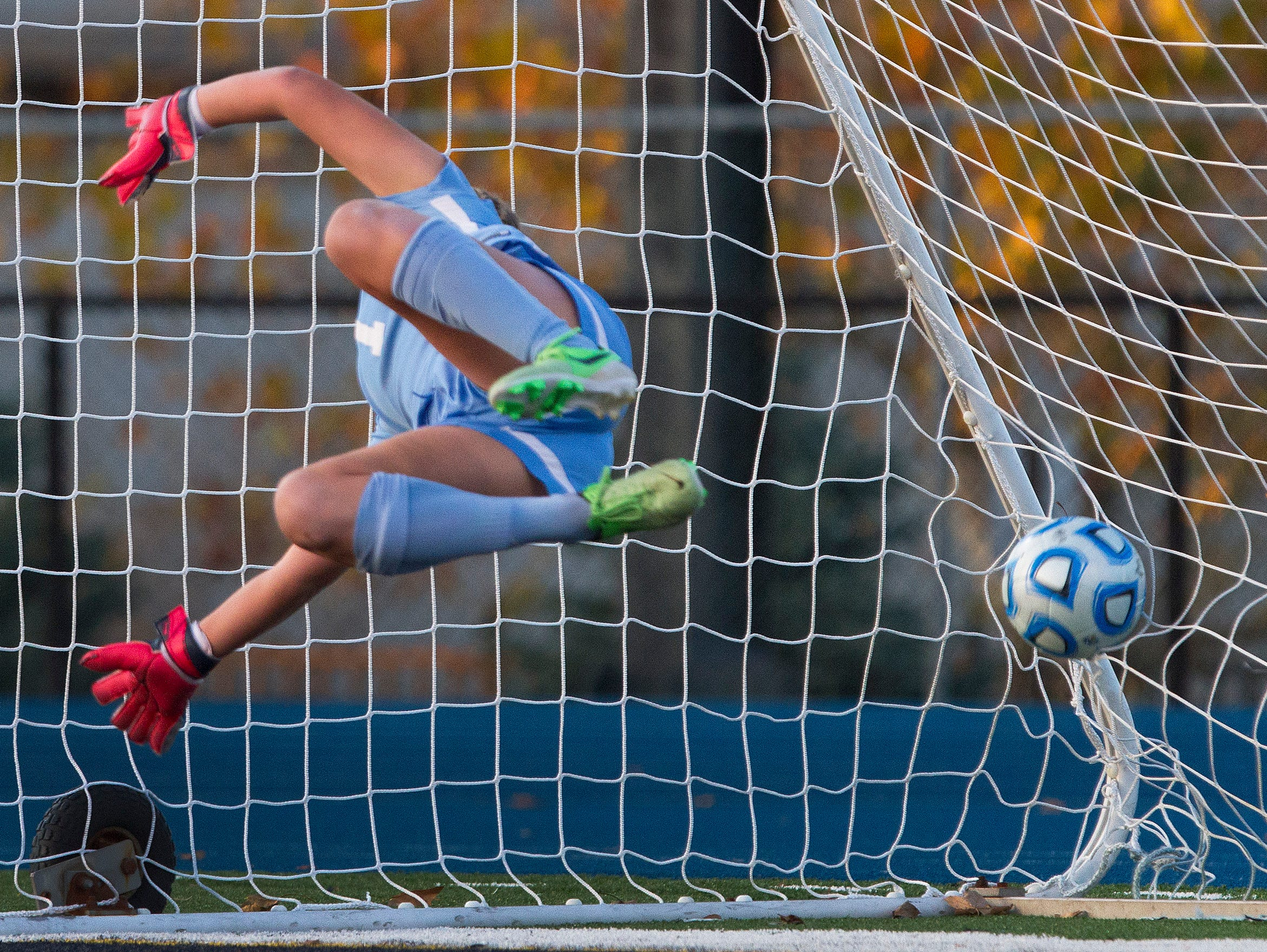 Northern Highlands goalie Kayla Klatt dives for but can't get to penalty shot by Colts Neck's Frankie Tagliaferri that put Colta Neck ahead 1-0. Colt Necks Girls Soccer vs Northern Highlands in NJSIAA State Group III Championship at Kean University on November 21, 2015 in Union, NJ.