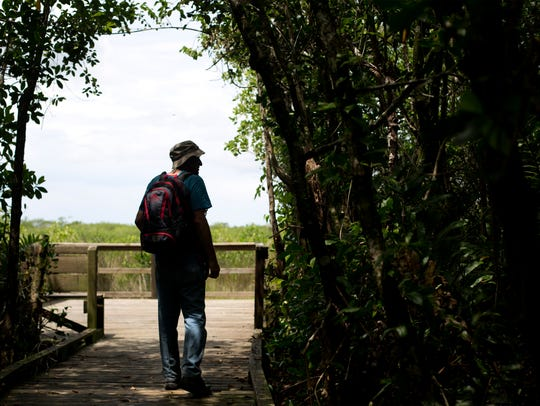Botanist George Wilder walks through Collier-Seminole