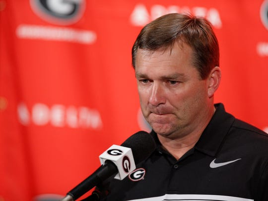 Kirby Smart has led Georgia to the top spot in the first College Football Playoff Top 25 poll released Tuesday. Whether he likes everything that comes along with it is another story.