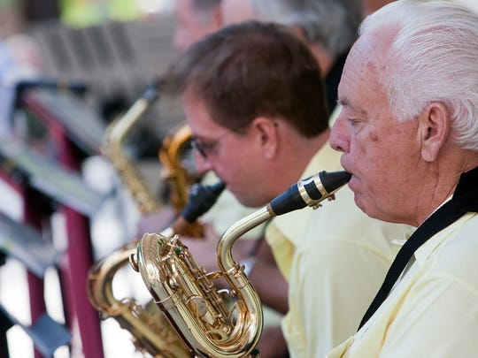 Bob Kennedy plays the tenor saxophone for the Gulf Coast Big Band during a free concert at Cambier Park.