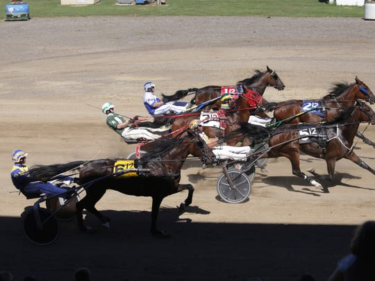 Horses race during Race 12 of the remembering Jackson Harness Raceway races, Sunday, July 8, 2018, at the Jackson County Fairgrounds in Jackson, Mich.  The raceway, which opened in 1948, will be demolished after next month's county fair.