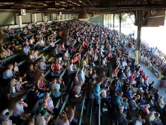 Spectators watch Race 4 of the remembering Jackson Harness Raceway races, Sunday, July 8, 2018, at the Jackson County Fairgrounds in Jackson, Mich. The raceway, which opened in 1948, will be demolished after next month's county fair.