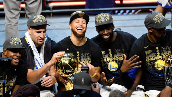 The Golden State Warriors celebrate after defeating the Cleveland Cavaliers in Game 4.