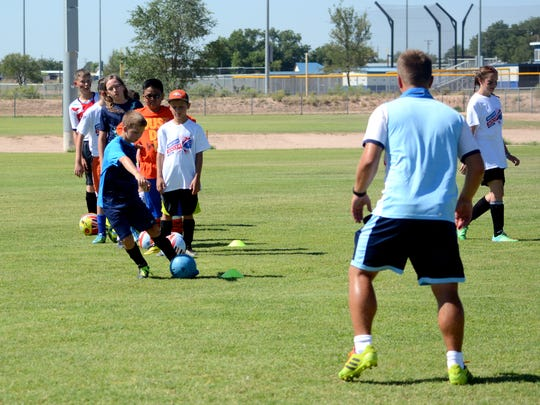 Ryan Vaught, 10, fires a shot during the British Challenger Soccer Camp Wednesday at Bob Forrest Youth Sports Complex.