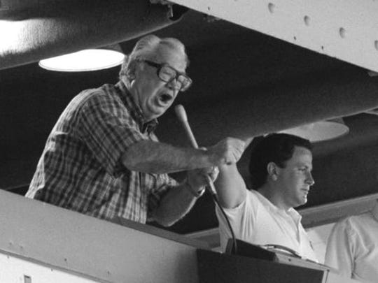 """FILE - In this undated photo, Chicago Cubs broadcaster Harry Caray sings """"Take Me Out to the Ball Game"""" during a Chicago Cubs baseball game at Wrigley Field. Brewer Anheuser-Busch honored the legendary sportscaster, who died in 1998 having not seen his beloved Cubbies make it to the World Series, with a video that had him calling the end of Game 7, with the Cubs defeating the Cleveland Indians in an extra-inning 8-7 nail biter. The brewer also resuscitated 1984 Budweiser ad in which the Bud pitch man, and consumer, caught a cold one launched into the Wrigley Field bleachers using a net."""